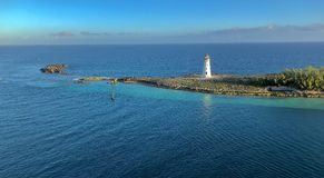 Lighthouse on cape. A panoramic view of a lighthouse on a cape and open sea in the background Stock Image