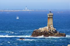 Lighthouse on Cape Sizun, Pointe du Raz. Royalty Free Stock Photography