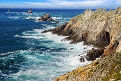 Lighthouse on Cape Sizun, Pointe du Raz. Stock Photo