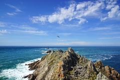 Lighthouse on Cape Sizun, Pointe du Raz. Royalty Free Stock Photo