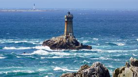 Lighthouse on Cape Sizun, Pointe du Raz. Royalty Free Stock Image