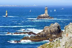 Lighthouse on Cape Sizun, Pointe du Raz. Royalty Free Stock Photos