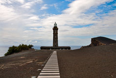 Lighthouse Capelinhos on the cliffs of island Faial, Azores Stock Photography