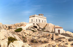 lighthouse at capo testa - sardinia, italy Royalty Free Stock Photo