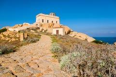 Lighthouse at Capo Testa, Sardinia, Italy Stock Photo