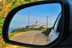 Lighthouse in the car mirror Stock Photography