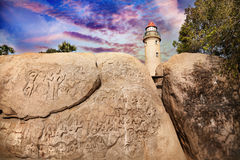 Lighthouse and carving rock in India Stock Photo