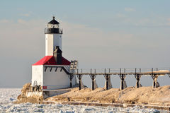 Lighthouse and Catwalk on Sunny Day in Winter royalty free stock photo