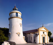 Lighthouse and Chapel at Guia Fort in Macau, China. Built in 1865, this 15m-tall lighthouse is the oldest in South China Coast. It is located at fort Guia, the Stock Photography