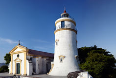 Lighthouse and Chapel at Guia Fort in Macau, China. Built in 1865, this 15m-tall lighthouse is the oldest in South China Coast. It is located at fort Guia, the Royalty Free Stock Image