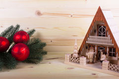 Lighthouse with christmas balls and light-colored wooden background Royalty Free Stock Images