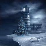 Lighthouse and christmas tree Stock Photo