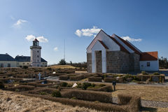 Lighthouse and Church Royalty Free Stock Image