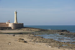 The lighthouse of the city of Rabat in Morocco. Rabat is the economic and administrative capital of Morocco. Magnificent beach where Moroccans will relax  flirt Royalty Free Stock Photo