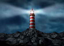 Lighthouse Clearing The Path. On a rock mountain as a strategic guidance symbol with a beaming directional light business concept with a high tower for security Stock Photo