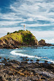 Lighthouse on a Cliff Royalty Free Stock Images
