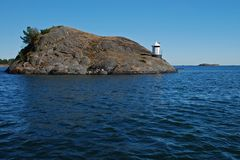Lighthouse on cliff Royalty Free Stock Photos