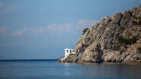 Lighthouse on a cliff in the Aegean sea. Travel. Royalty Free Stock Image