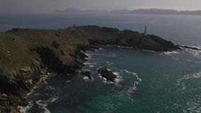 Lighthouse on a cliff on the background of the ocean top view. 4k video from the drone stock video footage