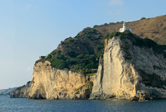 Lighthouse on cliff of Cape Miseno, Bacoli - Naples – Italy Royalty Free Stock Photo