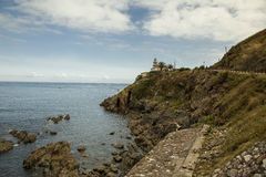 Lighthouse in the cliff, Cudillero in Asturias Royalty Free Stock Photography