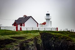The lighthouse on a cliff in Dingle, Ireland Stock Photography
