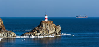 Lighthouse on a cliff by the sea. East (Japan) Sea. Stock Image