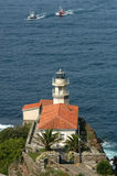 Lighthouse on a cliff, Spain Stock Images