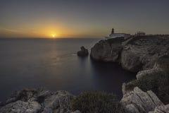 Lighthouse cliff sunset stock image