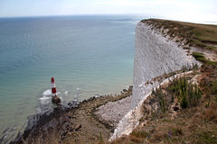 Lighthouse And Cliffs Of Beachy Head. Vertical cliff drop at Beachy Head, with the lighthouse just perched off the coastline stock images