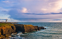 Lighthouse on cliffs, Hook Head, Ireland Royalty Free Stock Images