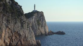 Lighthouse on the cliffs at Lefkada, Ionian sea, Greece. UHD 4K stock video