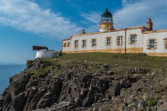 Lighthouse on the cliffs of Neist Point stock photos