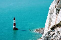 Lighthouse and cliffs Stock Photography