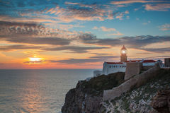 Of lighthouse and cliffs St. Vincent at sunset. Stock Photos