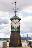 Lighthouse, Clock on the promenade in Aker Brygge in Oslo, Norway Royalty Free Stock Photo