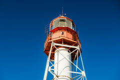 Lighthouse. Close up. Red and white, blue sky. Latvia, Pape Stock Image