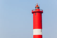 Lighthouse Closeup Ships Helper. Lighthouse closeup red white structure ships helper from dangers Royalty Free Stock Images