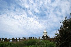 LIGHTHOUSE WITH CLOUD AND VEGETATION Stock Photos