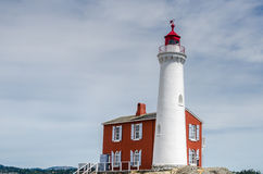 Lighthouse on a Cloudy Day. Fisgard Lighthouse on a Cloudy Day. Victoria, British Columbia, Canada Stock Photo