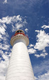 Lighthouse and cloudy sky Stock Images