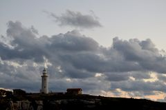 Lighthouse on cloudy sky backgound. Pathos, Cyprus Royalty Free Stock Image