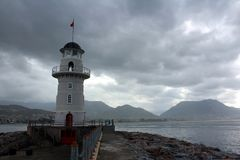 Lighthouse in cloudy weather in Alanya stock image