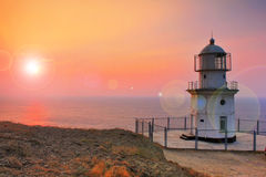 Lighthouse on the coast. At dawn Royalty Free Stock Photo