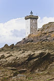 Lighthouse by the coast in Britain with clouds Royalty Free Stock Photo