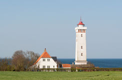 A lighthouse by the coast of Funen. By the coast of funen there is a lot of lighthouses and this is one of them Royalty Free Stock Photos