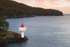 Lighthouse on the coast of Norwegian Sea stock images