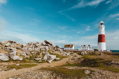 Lighthouse on coast of Portland, Dorset, England on summer day w. Lovely summer scene in Dorset England Royalty Free Stock Photos