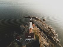 A lighthouse at the coast of the sea stock image