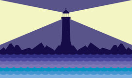 Lighthouse on the coast. Lighthouse is sending out it's warning signal Stock Images